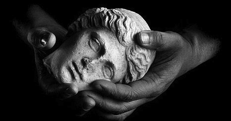 morlock-hands-cradling-stone-head