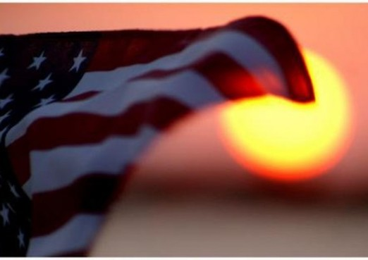 american-flag-waving-sunset