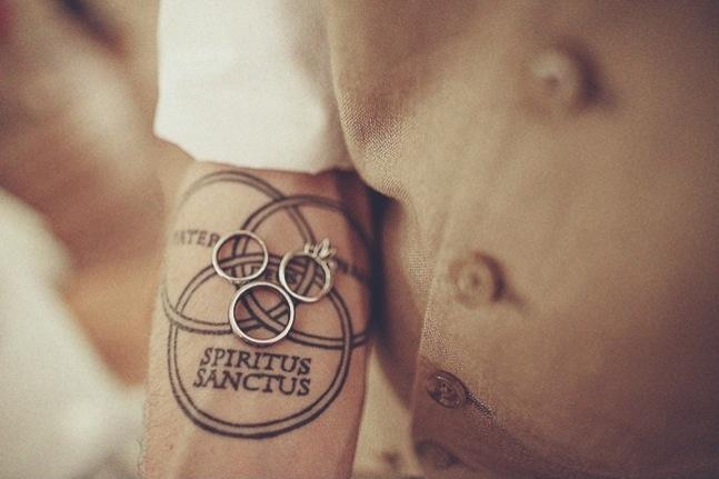 monica-ben-wedding-rings-trinity-tattoo-arm